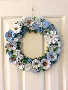 Add a splash of color to your home with this beautiful wreath. All cones are hand painted and wired and coated with a clear acrylic spray. Wreath measures 13.5 x 13.5.