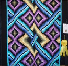 Here is part 4 of our four-part series on bargello quilts. Today we're featuring the intricate and colorful designs of Dereck C. Lockwood. H...
