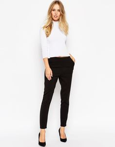Trousers by ASOS Collection Smooth woven fabric High-rise waist Twin side pockets Side zip fastening Slim fit - cut closely to the body Machine wash Polyester, Viscose, Elastane Our model wears a UK 4 and is 175 tall High Waisted Black Trousers, Cropped Trousers, Trousers Women, Black Pants, Tall Pants, Asos, High Rise Pants, Models, Mannequin