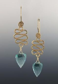Moldovite faceted pendulum shaped stones hang from hand-hammered gold-filled hairpin wave design. Hand-hammered swirl ear wires.