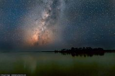 This particular photo showing a large body of water under a starlit sky was also taken in Cedar Key, Florida