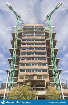 Photo about Two cranes surrounds a new residential property development. Image of residential, building, construction - 134225303 Property Development, Crane, Building, Buildings, Construction