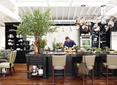 White ceiling brightens black kitchen while wood floor adds warmth... Love.