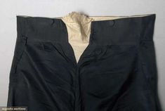 "TWO PAIR WEDDING BREECHES, AMERICA, c. 1810  Lot: 185 November 13, 2013 - NYC New York City 1 pair black silk twill fall front trousers, self covered buttons, belonged to Ephraim Ingalls, born 1805 & married 1821; 1 pair wool faille breeches, sewn-on tag marked ""1810 wedding clothes""; excellent.   Price Realized: $ 1440.00 Category: Gents Era: 1800-1850 29.13480.238.185"