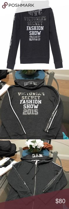 Victoria's Secret fashion show 2015 bling jacket NEGOTIABLE! NO LOWBALL OFFERS! Retail $79.95  Victoria's Secret fashion show 2015 bling hoodie/jacket!  BRAND NEW! NWT  Has NYC in bling on the hood and VICTORIAS SECRET in sequin bling on the back followed by fashion show in white font ending with 2015 in sequin bling   Has an angel wings zipper and angel wings in the right corner as pictured   Size X-SMALL Victoria's Secret Jackets & Coats