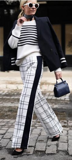 Blogger Blair Eadie of Atlantic-Pacific ready for Fashion Week with her Tory Burch bag