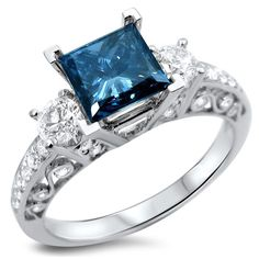 <li>Blue and white diamond ring</li><li>18k white gold jewelry</li><li><a href='http://www.overstock.com/downloads/pdf/2010_RingSizing.pdf'><span class='links'>Click here for ring sizing guide</span></a></li>