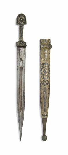 A NIELLOED SILVER-MOUNTED DAGGER (KINDJAL) - OTTOMAN TURKEY, 19TH CENTURY.