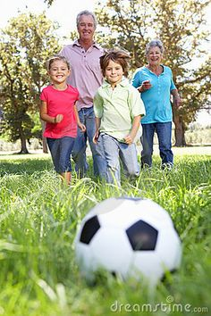 Grandparents playing football with grandchildren by Monkey Business Images, via Dreamstime