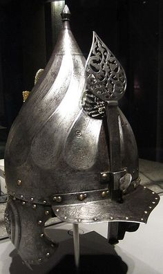 Chichak, a type of helmet (migfer)  with Saint-Irene Arsenal mark, originally worn in the 15th-16th century by cavalry of the Ottoman Empire, consisting of a rounded bowl with ear flaps, a peak with a sliding nose guard passing through the peak, and an extension in the back to protect the neck. Other countries versions of the chichak including Mughal India, in Europe the zischagge helmet was a Germanisation of the original Turkish name. Museum of Islamic Art, Doha Port,  Doha Qatar.