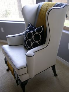 Remember this wing back chair? I found it approx. 2 1/2 years ago at an antique store. It was upholstered in dirty, stinky blue fabric. I h...