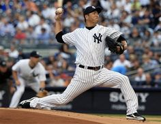 GAME 57: Friday, June 8, 2012 - New York Yankees' Hiroki Kuroda, of Japan, delivers a pitch during the first inning of an interleague baseball game against the New York Mets in New York. (AP Photo/Frank Franklin II)