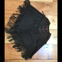 Vintage suede fringed poncho. Amazing true vintage piece from the late 60's early 70's. Dark brown with lace front detail and fringed all around. Please understand that vintage suede will have some scuff marks and imperfections, all part of the character. Jeans and boots all the way with this one :) size medium to large. Vintage Jackets & Coats