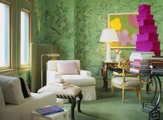 LOVE this wall paper and the furniture! I'd ditch the modern art and stack of fuchsia boxes though.