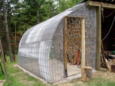 attached lean-to shed made out of cattle panels - use as storage or extra greenhouse...or chicken house!