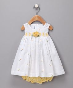 Yellow Daisy Dress and Diaper Cover ($19.99)...incredible prices and lovely.  I would have pinned EVERY one of them!
