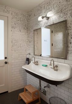 powder bath? What if we just do a funky floating sink and some cool wallpaper? Get rid of any heavy cabinetry.