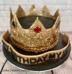 Cake decorated with fondant and modeling chocolate crown with isomalt jewels