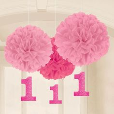 Prepare a pretty room for your little girl's first birthday. The Pink 1st Birthday Fluffy Danglers are paper pom-poms that brighten the space and add interest with the burst of tissue paper panache. T