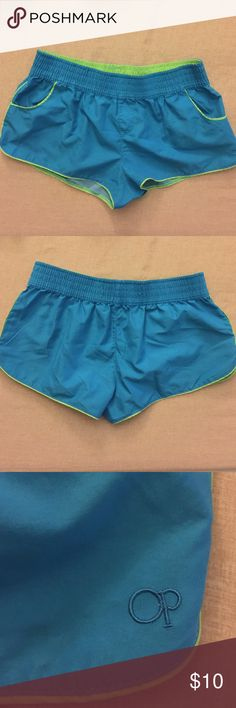 Women's workout shorts Super cute workout/running dry fit OP shorts. No tag but fit a size small-medium. Perfect condition! No flaws! They resemble Nike shorts buts these are Op. Op Shorts