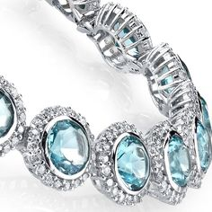 925 Solid Sterling Silver Tennis Link Bracelet set with simulated Aquamarines and Diamonds