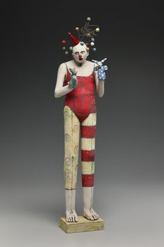 Nancy Kubale. Clowns are always a little bit creepy but this is still cool.