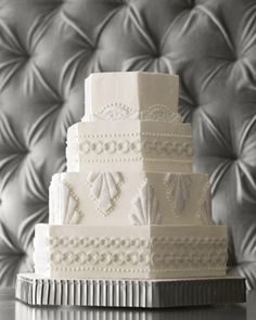 You don't need to know your Art Deco from your Art Nouveau to admire this cake's geometric Gatsby style. Covered in buttercream, piped dots of frosting, and cut-fondant plaques coated with sanding sugar, it's just plain pretty, no matter how you slice it.