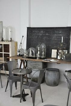 inspiration for future floral studio. rustic rustic rustic, woods, blackboard, and mixed containers.