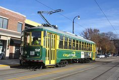 An old, vintage trolley car transverses the new Charlotte, North Carolina street car line in December, 2016. The trolley is vintage, but the street car line is new, having opened in summer of 2016 on Charlotte's Elizabeth Street. Charlotte Area Transit System (CATS, for short) plans to acquire new, modern street cars when the Gold Line extension is completed in a few years. Line Extension, Elizabeth Street, Railroad Photography, Chester, Lancaster, North Carolina, Charlotte, December, Cars