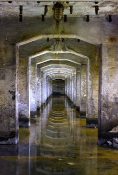 Beautiful industrial repetition and reflection in the semi flooded basement at an abandoned coke works. Photograph © Matthew Emmett.
