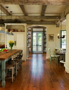 New Country French Cottage kitchen inspired by old French homes.  Love the beams, lights, floors, island, and aqua accents.