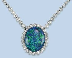 A belle epoque black opal and diamond necklace. The oval black opal within millegrain diamond-set surround and necklace with loop link backchain, circa cm long Opal Necklace, Opal Jewelry, Necklace Set, Fine Jewelry, Jewelry Necklaces, Pendant Necklace, Edwardian Jewelry, Vintage Jewelry, Jewelry For Her