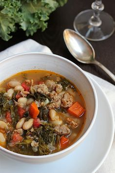 kale, white bean and spicy turkey sausage soup. Savor Home Spicy Bean Soup, Kale And Bean Soup, Bean Soup Recipes, White Bean Soup, Healthy Soup Recipes, White Beans, Healthy Cooking, Cooking Recipes, Crockpot Recipes