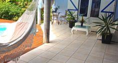 Maison d'Hôtes Adé - Gosier - Terrasee privative pour une seule chambre pour 2 pers en 1/2 pension, incluant le linge et la prise en charge Aéroport - Piscine privative et wifi - A réserver sur le site Régionelles, rubrique Tourisme