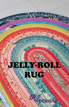 Jelly Roll Rug - Approximately 30in x 44in area rug made from one Jelly-Roll, forty-two 2-1/2 inch fabric strips, and 100 percent cotton batting.