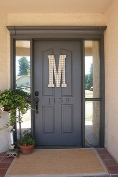 Love the monogram for the door --- and the house number placement! - sublime-decor