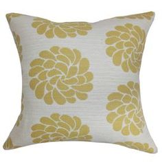 "Cotton blend pillow with a floral motif and down fill. Made in the USA.  Product: PillowConstruction Material: Cotton blend cover and 95/5 down fillColor: Yellow and whiteFeatures:  Insert includedHidden zipper closureMade in the USAPrinted on front and back Dimensions: 18"" x 18""Cleaning and Care: Spot clean"