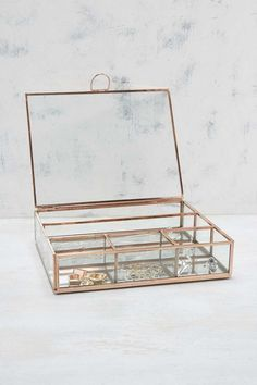 This dainty jewellery box from Urban Outfitters.   21 Things For People Who Want To Fill Their House With Copper