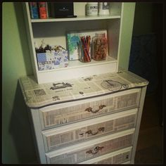 I've recycled my childhood dresser into a craft supply storage cabinet. I decoupaged vintage dictionary pages and added a small bookcase on top.