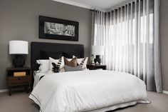 Centre opening eyelet curtains in striped linen fabric, with black colour, continuous nickel rods. | Window Furnishing: Curtains | Room: Bedroom
