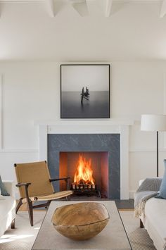 Simple white wooden fireplace surround with slate insert (to match floors of wet rooms) Alternative to stone. May keep stone for living room but have this style for master bedroom