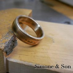 We made this brand new wedding band with an antiqued and rustic finish. #wedding #weddingrings #mensring #menstyle #customjewelry #simoneandson #orangecounty