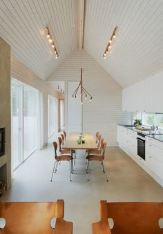 Kvist and Star lights in copper designed by Jonas Bohlin for Örsjö in this beautiful kitchen in Yngsjö, Sweden by Jordens Arkitekter