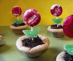 Lollipop Flower Pots from Food.com:   These candies/cookies look like little pots, complete with dirt and flowers growing out of them. So cute, especially for any spring time function where there's children. Too Cute!!