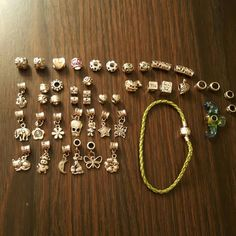 "Bracelet and Charm Lot! Price is for everything shown! Bracelet is braided faux leather, 8"". These are not Pandora  Thank you! Jewelry Bracelets"