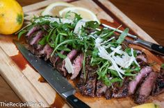 Grilled marinated flank steak with arugula.  Oh my.  Tender and juicy! I first saw a photo of this flank steak on Pinterest and it definitely got my attention. I'm so glad I tried it -- it's delicious, easy, juicy and tender. Very photogenic too! According to This ...