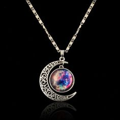 NEW Galaxy Moon Necklace This necklace is really beautiful. Brand new still in the wrapping. It is just as pictured & is gorgeous on. Great quality & is such a great piece to have! No disappointment at all. Jewelry Necklaces