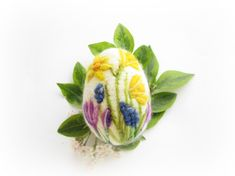 Needle felted egg made from pure roving wool one single barbed needle and lots of love. Walking in a wildflower meadow is a sure sign of spring and summer . . this needle felted egg mini landscape focuses on lovely spring flowers,daffodils,crocuses and muscari.. With vivid colors,