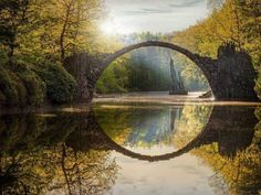 The 20 Most Beautiful Places in Europe Rakotz Bridge, Kromlau, Germany; The 50 Most Beautiful Places in Europe - Condé Nast Traveler Places In Europe, Places Around The World, Places To Visit, Rakotz Bridge, Landscape Wallpapers, Dark Hedges, Rhododendron Park, Poster Art, Strange Places