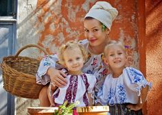 family.. Romanian traditional folk costume
